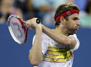 Mardy Fish returns a shot to Gilles Simon, of France, during a match at the U.S. Open tennis tournament, Saturday, Sept. 1, 2012, in New York. (AP Photo/Darron Cummings)